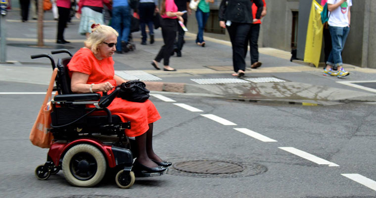 P-in-home-Older-lady-in-motorised-wheelchair