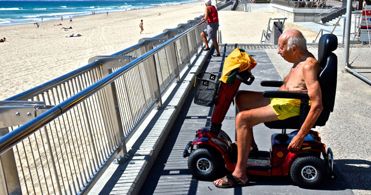 P-independent-Man-at-beach-in-motorised-chair