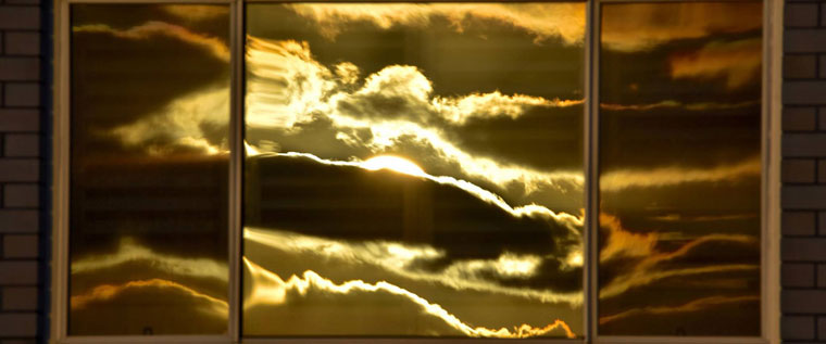 P-Info-Sunrise-reflected-in-trio-of-windows