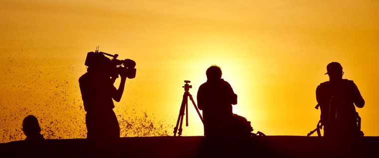 P-Media-at-work-silhouetted-in-golden-sunrise
