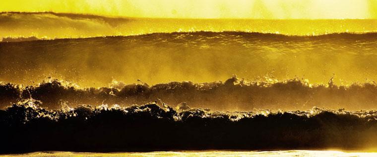 P-Medication-Wide-shot-of-golden-waves-crashing-onshore