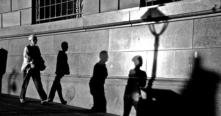 P-personal-safety-B&W-older-lady-walking-with-3-shadows