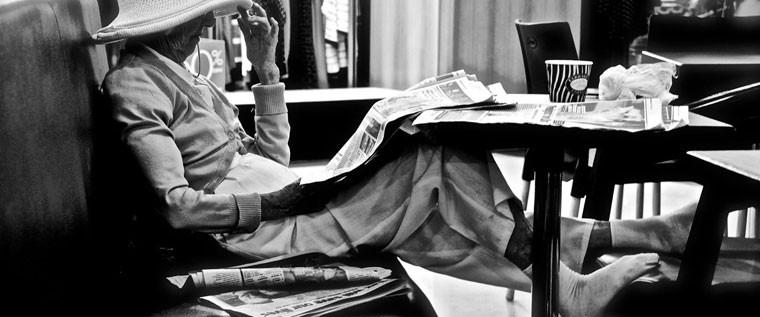 P-policy-Older-lady-reading-newspaper