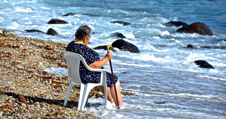 P-staffing-lady-seated-with-cane-in-shallows